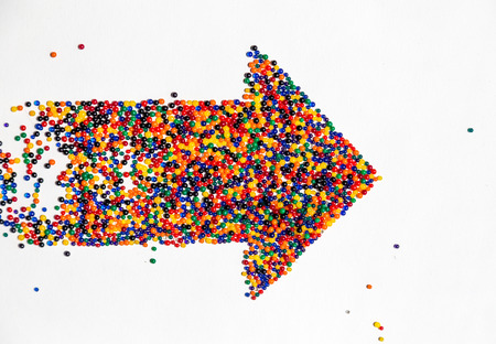 flecha: Flecha puntos de color gráfico, desarrollo progresivo de significado. Foto de archivo