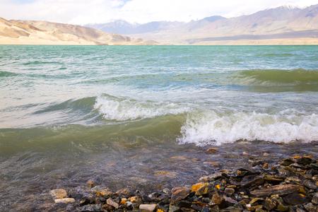 Plateau Lake waves crashing on seashore