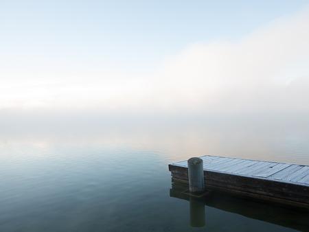 Frosty pier in fog on a foggy lake Stok Fotoğraf