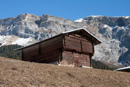 Swiss alpine hut in foreground of the Flimserstein mountain range in canton GraubŸnden Switzerland. Editöryel