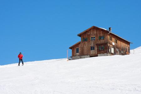 Adult skier doing snow plow at Clavadeler Alp, Davos,Switzerland