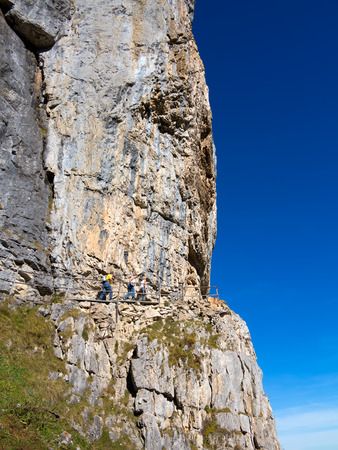 Steep mountain cliff hikers in Switzerland Stok Fotoğraf