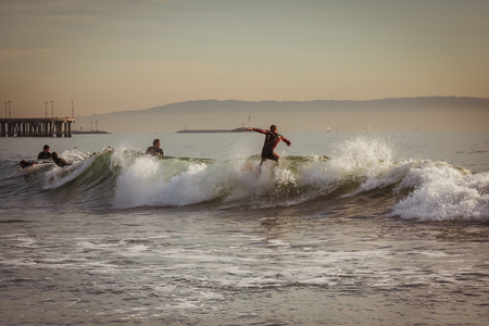 California surfers practicing on small waves Stok Fotoğraf - 91706580