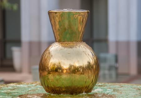 Reflective golden colour geometric vessel
