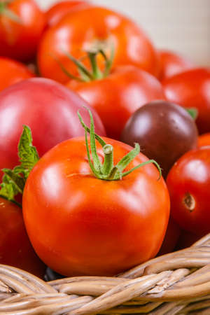 Close up of fresh tomato in a basket