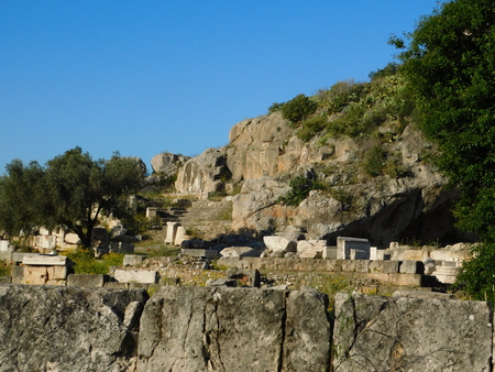 April 2018, Eleusis or Elefsina, Greece, The road to the secret ceremony building and the holy cave of Pluton or Plutonium Foto de archivo - 99396176