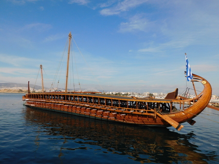 "December 2018, Faliro, Athens, Greece. A trireme, full scale replica of an ancient warship. The sign shows its name ""Olympias"""