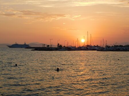 Sunset from the shore of Glyfada, Greece Фото со стока