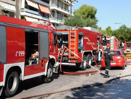 October 1st, 2020, Glyfada, Athens, Greece.  Fire brigade trucks in action, near a burning shop