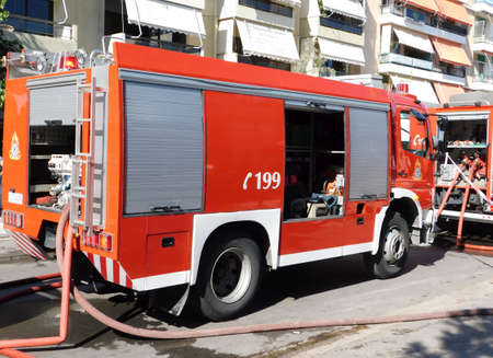 October 1st, 2020, Glyfada, Athens, Greece.  A Fire brigade truck in action, near a burning shop