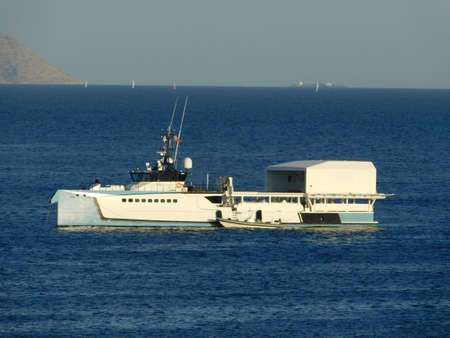 A luxury yacht support vessel, off the coast of Vouliagmeni in Attica, Greece