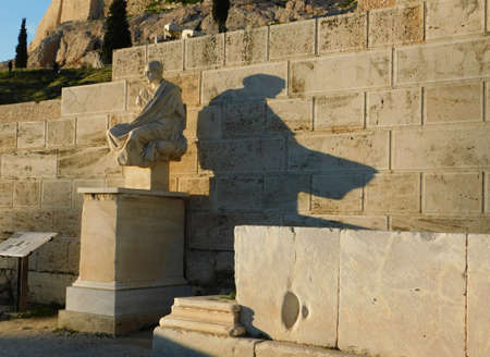 January 2019, Athens, Greece.  The ancient comedy writer Menandros, throws his shadow on Dionysus theater, under the Acropolis