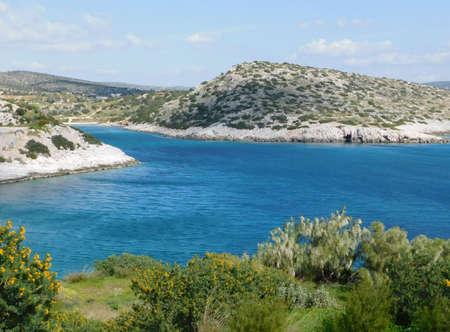 View of the sea and rocky coastline, on a sunny day in Attica, Greece