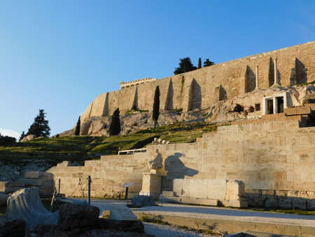 January 2019, Athens, Greece. View of the ancient theater of Dionysus, on the south slope of the Acropolis hill, and its walls