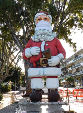 November 2020, Glyfada, Greece. A huge Santa wearing a mask for the COVID-19 pandemic Editorial