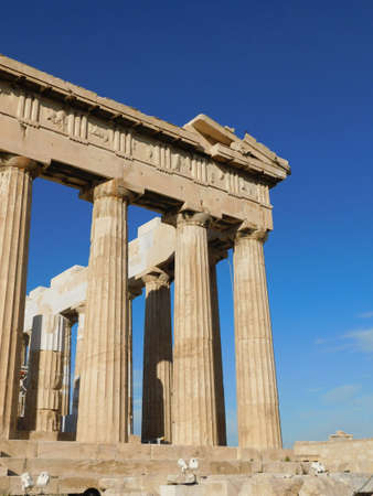 Corner columns and sculptures of the Parthenon, the ancient temple of goddess Athena, in Athens, Greece