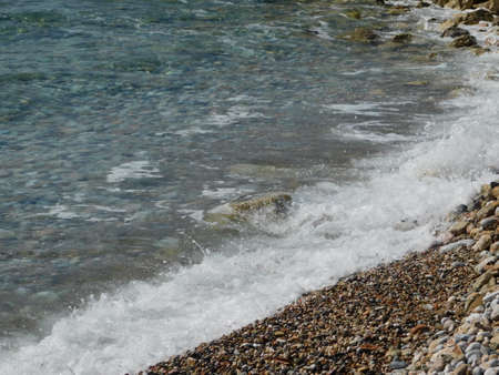 Sea waves on a beach in Glyfada, Attica, Greece