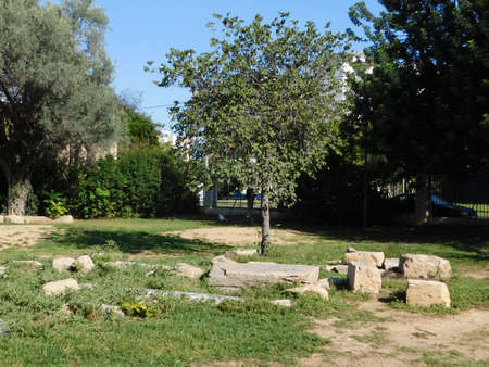 October 2018, Athens, Greece. The ancient site of Plato's Academy. Old stones in the park