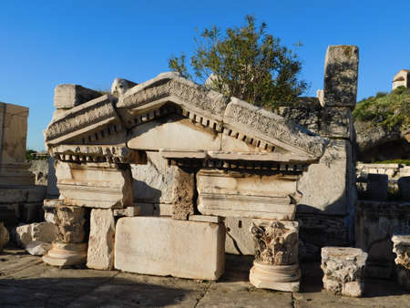 April 2018, Eleusis or Elefsina, Greece, Part of an ancient arch with a pediment and columns