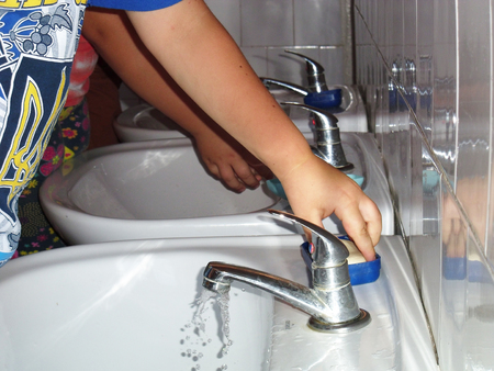 It is very important from childhood to teach children to wash hands thoroughly. This is to a great extent will help avoid infectious diseases. Stock Photo