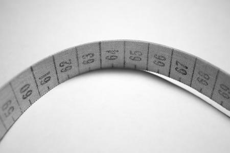 metro de medir: cinta métrica enredado. La medición medidor de blanco y negro