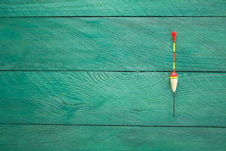 fishing float: fishing float on a wooden surface the background turquoise colors