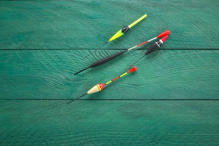 fishing floats: Four fishing floats on a wooden surface the background turquoise colors Stock Photo