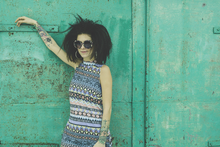 stylization: Laughing African young woman with an afro hairstyle wearing sunglasses and pastel stylization Stock Photo