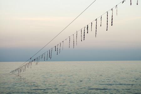 polea: El cable entra en el mar. Costa