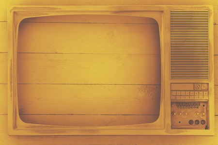 Old TV screen is coated with white acrylic paint. On a white wooden background. Excellent retro. Creative decor. Sepia effect. Secured by modern style.