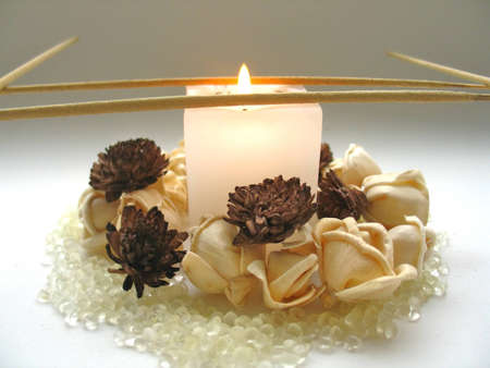 incense sticks: Candle, flowers and incense sticks Stock Photo
