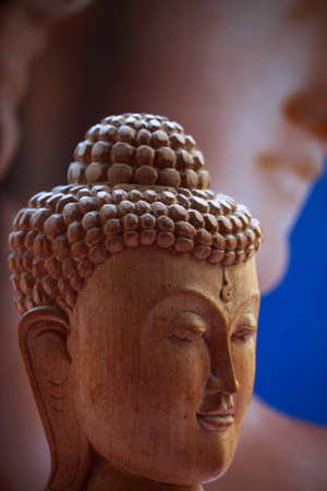 Wood carving of buddha