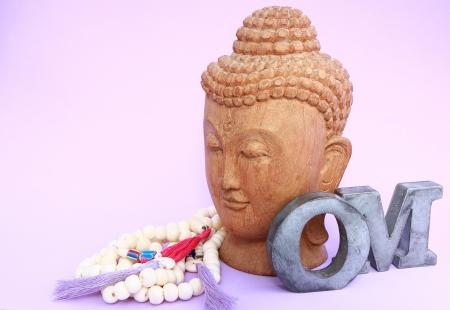 Buddha with necklace and OM Banco de Imagens