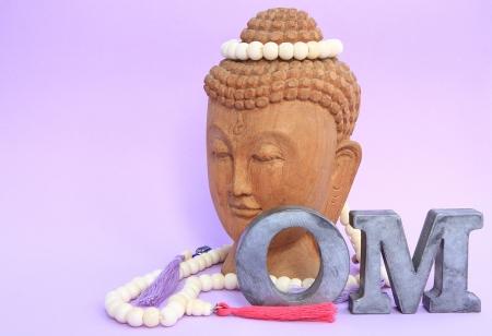 om symbol: Buddha with necklace
