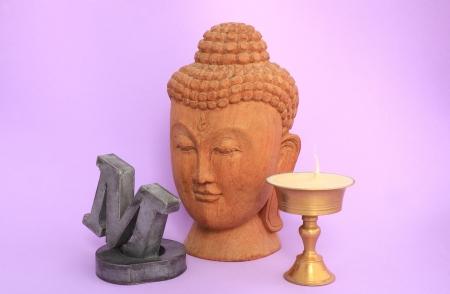 Om,candlestick and buddha Banco de Imagens