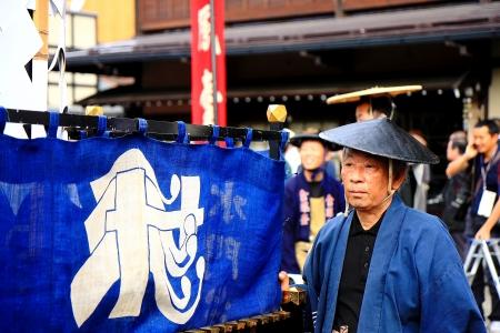 participant: TAKAYAMA, JAPAN - OCTOBER 10  Participant file in the Takayama Festival on October 10, 2013 in Takayama