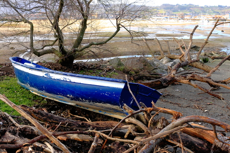 stranded: Blue boat stranded