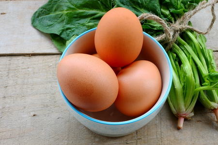chicken or egg: Eggs and spinach Stock Photo