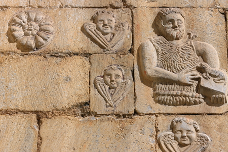 shephard: Stone carving on the church wall