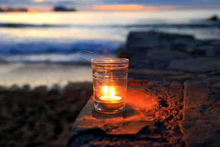 Candle in Zarautz beach photo
