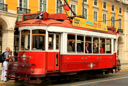 tramcar: LISBON,PORTUGAL-APRIL 12, 2014  Tourists goes up to the tram in the center of Lisbon on April 12, 2014 in Portugal  Editorial
