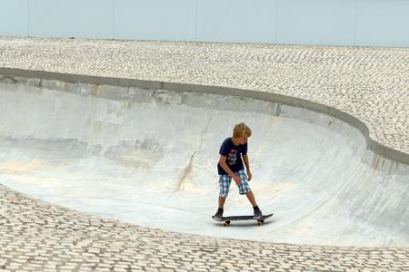 skat: BIARRITZ, FRANCE - JULY 28, 2014: Skater boy trains his hobby in the skate park on July 28, in Biarritz-France.