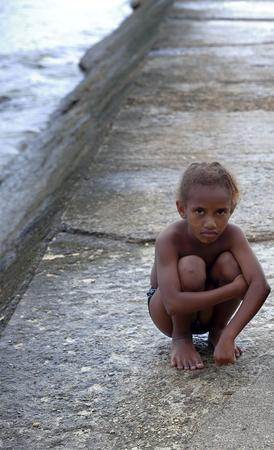 youngs: ESPIRITU SANTO,VANUATU-OCTOBER 15, 2014: Local people wait for tourists cruises local crafts to sell on October 15, in Luganville-Vanuatu.