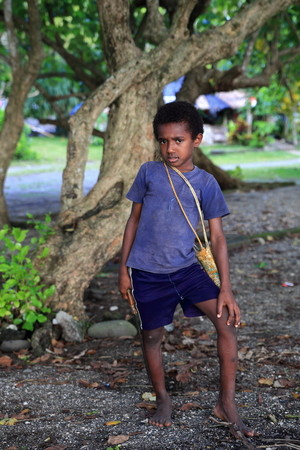 youngs: PANGI,VANUATU-OCTOBER 14, 2014: Young locale goes to school with traditional machete to cross the jungle  on October 14, in Pentecost-Vanuatu.
