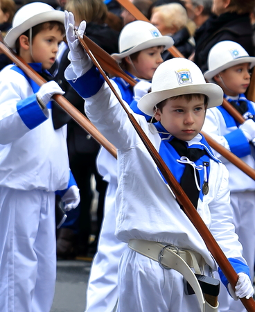 basque woman: DONOSTIA, SPAIN - JANUARY 20: Local boys in traditional dress participate in the parade of his city.s holiday on January 20, 2015 in San Sebastian-Spain. Editorial