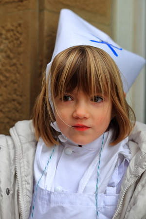 basque woman: DONOSTIA, SPAIN - JANUARY 20: Local little girl in traditional dress participate in the parade of her city.s holiday on January 20, 2015 in San Sebastian-Spain.