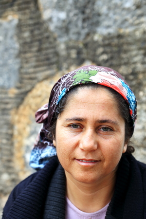 merchandiser: SIMENATURKEYAPRIL 02 2015: Local merchant watches the tourist sitting at the castle gateway on April 02 Turkey.
