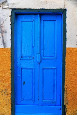 blue door: Blue door on yellow wall