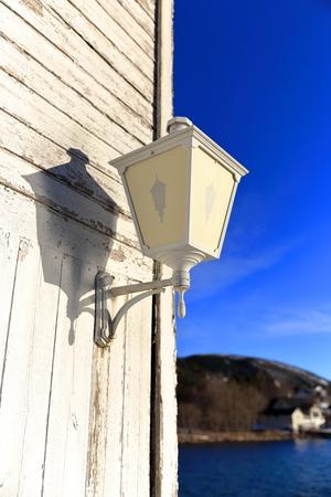 streetlight on a white cabin