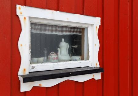 artic circle: little window of a cabin in Lofoten, Norway
